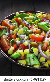 Salad with avocado, tomato, paprika, red onion and corn