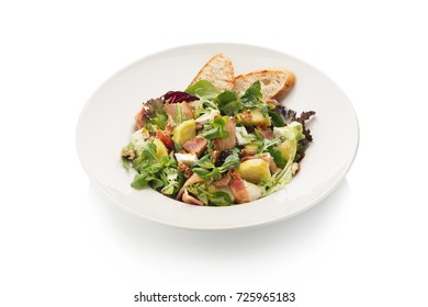 salad with bacon with apples and walnuts on a white background