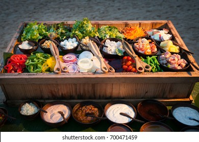 Salad Bar with fresh vegetables on ice.