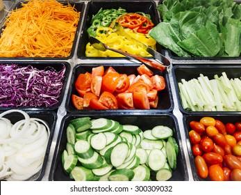 Salad Bar Fresh Vegetables sliced Tomato Carrot Celery Cucumber Cherry tomato