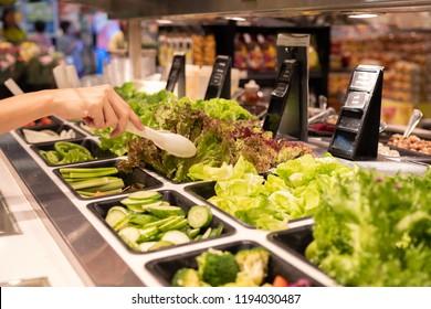 Salad Bar in Super Market holding vegetable
