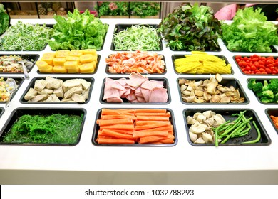 Salad bar with various fresh vegetables and other foods