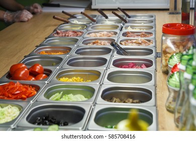 Salad bar with various fresh vegetables and other foods, close up, selective focus