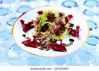 salad with beet cheese and pumpkin seeds