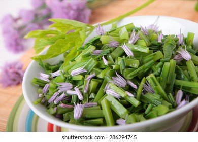 Salad of blanched goutweed with chive flowers and oil