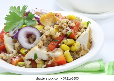 Salad with buckwheat, chicken,paprika, corn and onions