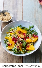 Salad with buckwheat, orange and pomegranate seeds