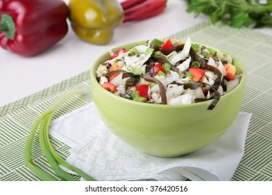 Salad of cabbage with laminaria, sweet pepper and spring onions in a bowl