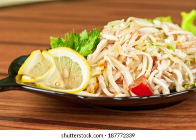 Salad with calamary and fresh vegetables