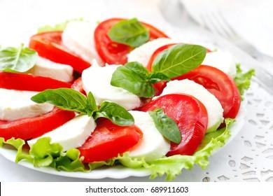 Salad caprese made of tomato, mozzarella and basil