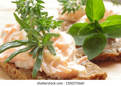 Salad with carots, herbs and mayonnaise on whole grain bread