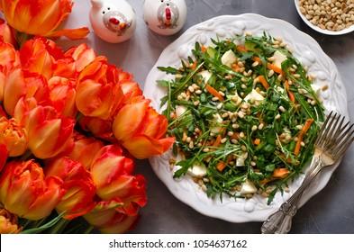 Salad with carrots of mozzarella avocado and corn oil