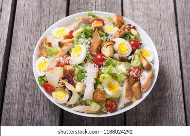 Salad ceasar with chicken , eggs , tomatoes and croutons