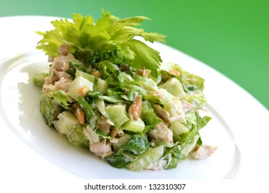 Salad with celery, chicken,  green apple and walnuts