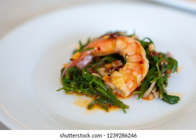 salad chakram and shrimp on dish