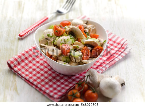 salad with champignon and tomatoes, selective focus