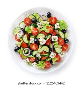 Salad with cheese and fresh vegetables isolated on white background. Greek salad. With clipping path.