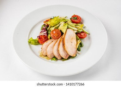 salad with chicken breast on the white plate