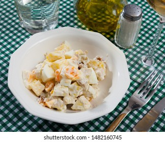 Salad of chicken breast, sweet pineapple, quail eggs, orange and mayonnaise sauce