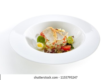 Salad with Chicken and Homemade Mayonnaise Isolated on White Background. Exquisite Serving Olivier Salat with Sliced Poultry Meat, Quail Eggs and Greens Close Up