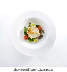 Salad with Chicken and Homemade Mayonnaise Isolated on White Background. Exquisite Serving Olivier Salat with Sliced Poultry Meat, Quail Eggs and Greens Top View