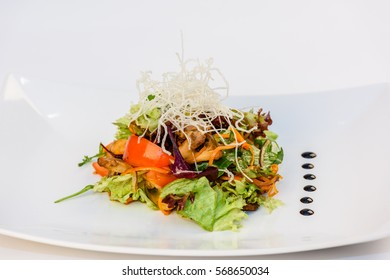 Salad with chicken meat, vegetables, noodles and greens