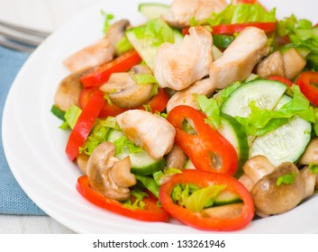 salad with chicken, mushrooms and vegetables