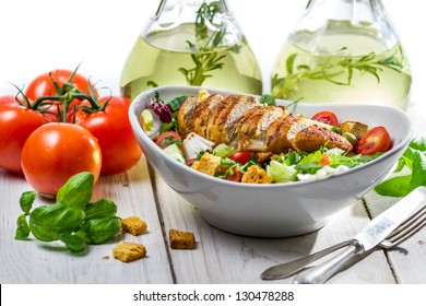 Salad with chicken, tomato, olive and fresh herbs