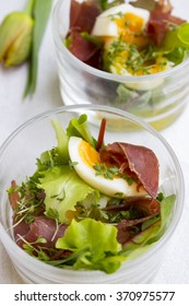 salad cocktail with eggs, basil and ham