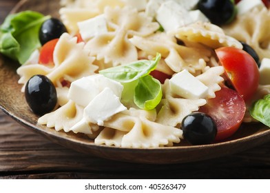 Salad with cold pasta and mozzarella, selective focus