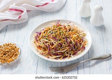Salad Cole slaw with red cabbage and wheat sprouts. Healthy detox food. On a blue wooden background.