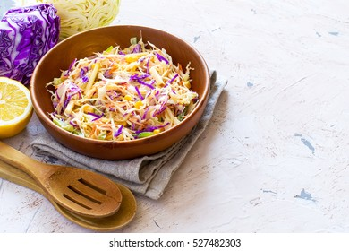 Salad coleslaw in a wooden bowl, rustic style, copy space
