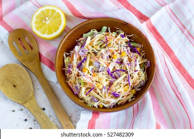 Salad coleslaw in a wooden bowl, rustic style, Top view