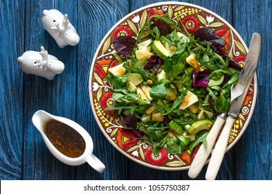 Salad with cucumber apple arugula and avocado