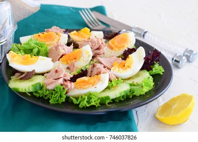 Salad with cucumber, eggs and tuna with olive oil, lemon and honey dressing. healthy eating concept