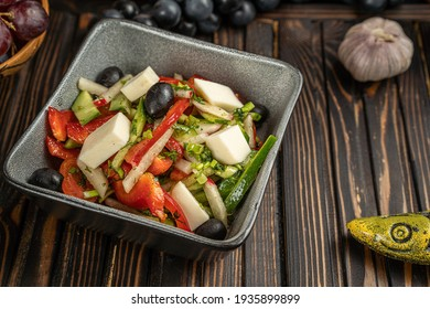 salad with cucumbers, tomatoes, red cabbage and arugula