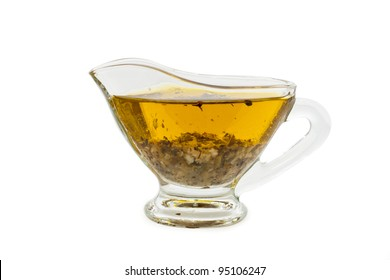 salad dressing with olive oil in glass sauce boat