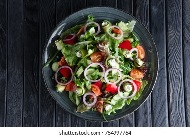 Salad with fresh cucumber, tomato, bell pepper, feta and onion