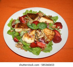 salad with fresh strawberries, grilled cheese and walnuts