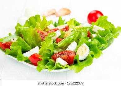 salad with fresh tomatoes, mozzarella cheese and quail eggs