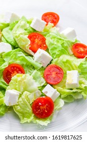 salad with fresh vegetables, feta cheese and tomatoes - Shutterstock ID 1619817625