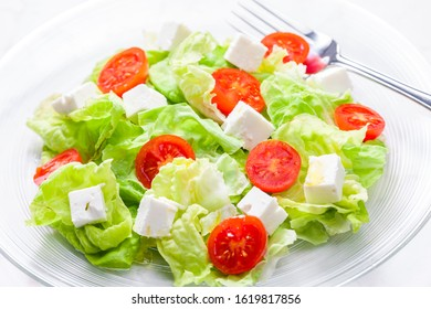 salad with fresh vegetables, feta cheese and tomatoes - Shutterstock ID 1619817856