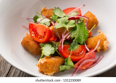 Salad with Fried cheese and tomatoes
