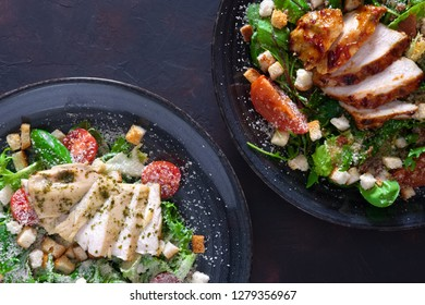 Salad with fried chicken and turkey  fillet , composition with two plates