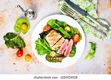salad with fried tuna, fresh salad with fish