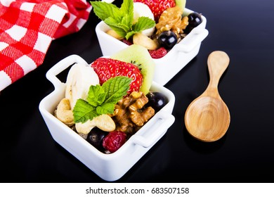 Salad with fruits and berries  - Shutterstock ID 683507158