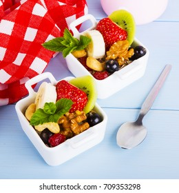 Salad with fruits and berries - Shutterstock ID 709353298