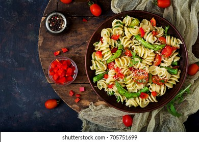 Salad - fusilli pasta with tomatoes, asparagus and sweet pepper. Flat lay. Top view