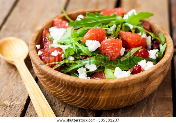 salad with grapefruit, arugula and cheese