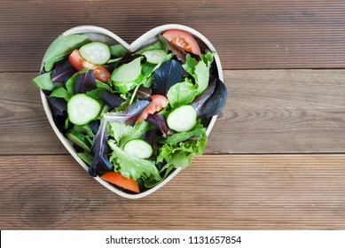 Salad Greens Mix Heart Shape Wooden Bowl Tomatoe Cucumber Health Concept Wooden Background Copy Space Top View